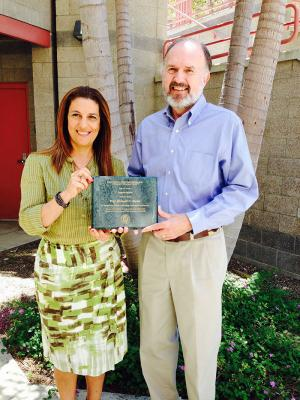 Founding Director Richard N. Taylor receives Award of Appreciation from Interim Director Cristina V. Lopes.