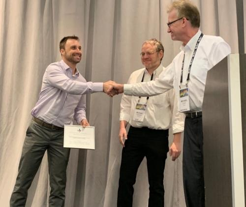 Jones receiving Most Influential Paper award at ASE 2019.